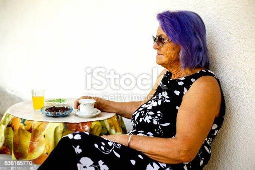 istock Elderly woman drinking a coffee 836185770