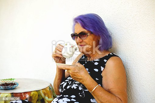 istock Elderly woman drinking a coffee 836188236