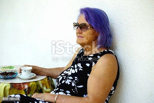 istock Elderly woman drinking a coffee 836188448