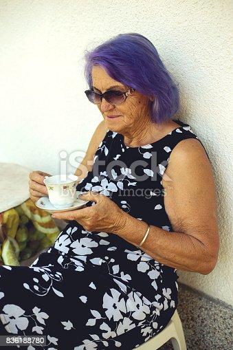 istock Elderly woman drinking a coffee 836188780