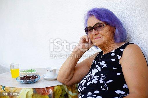 istock Elderly woman drinking a coffee 836189386