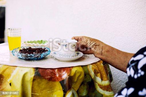 istock Elderly woman drinking a coffee 836191682