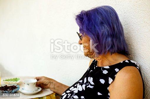 istock Elderly woman drinking a coffee 836191874