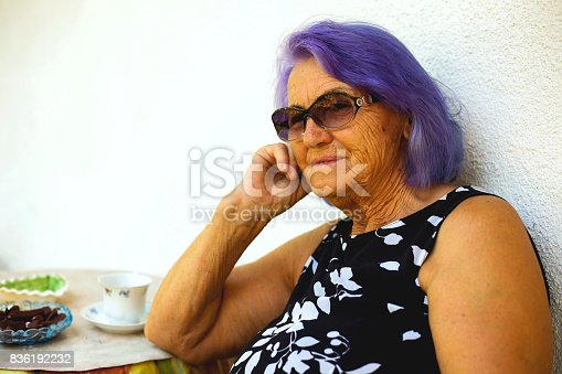 istock Elderly woman drinking a coffee 836192232