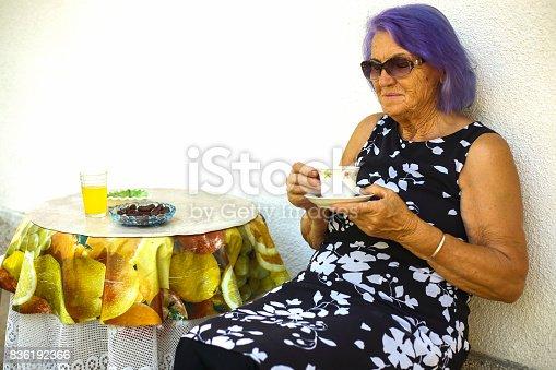 istock Elderly woman drinking a coffee 836192366