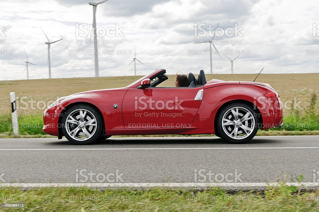 Elderly woman drives Nissan Convertible royalty-free stock photo