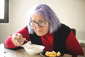 istock Elderly woman eats sitting at the table. 1134097972