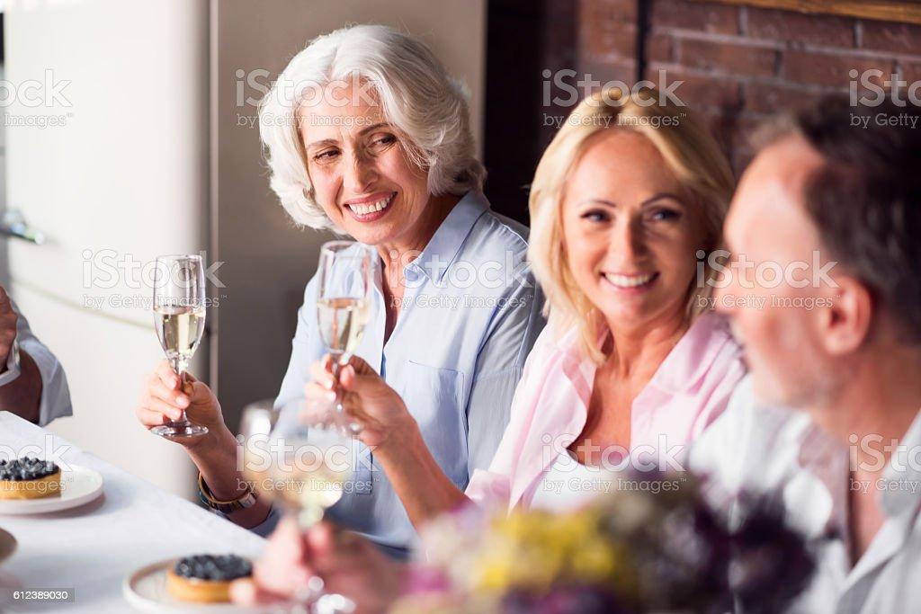 Elderly woman enjoying celebration with her family stock photo