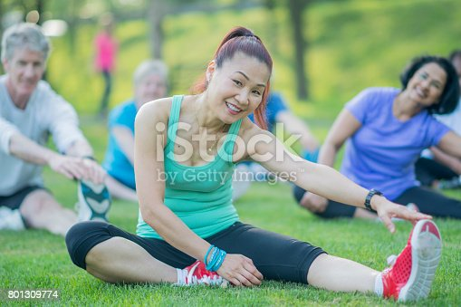 646614234 istock photo Elderly Woman Excercises with Group 801309774