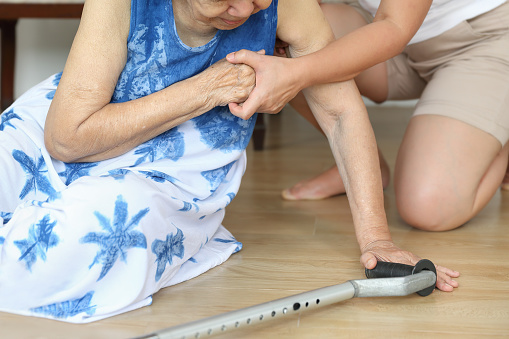 istock Elderly woman falling down at home ,hearth attack. 1028834348