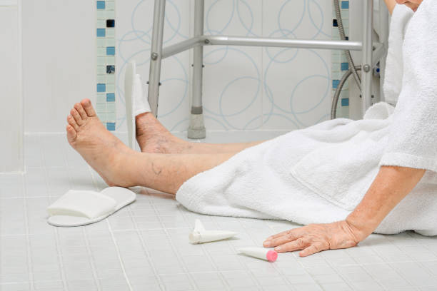 elderly woman falling in bathroom - fall prevention stock photos and pictures