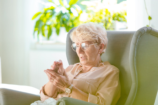 istock Elderly woman feeling numbness in her hand 1160184060