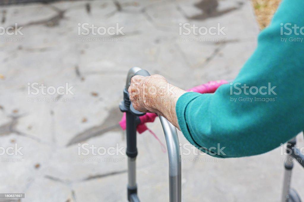 Elderly Woman Gripping Orthopedic Walker royalty-free stock photo