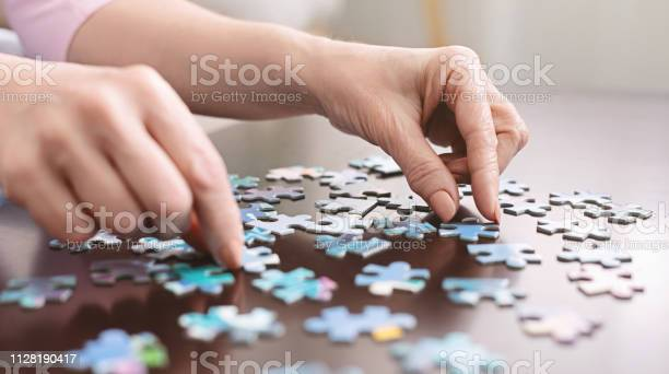 Elderly woman hands doing jigsaw puzzle closeup picture id1128190417?b=1&k=6&m=1128190417&s=612x612&h= 47kixpbosl4e55v 0mxpyl6nhr02oe4w3ymycmiseu=