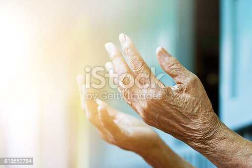 istock Elderly woman hands praying with peace of mind and faithfully. 613552784