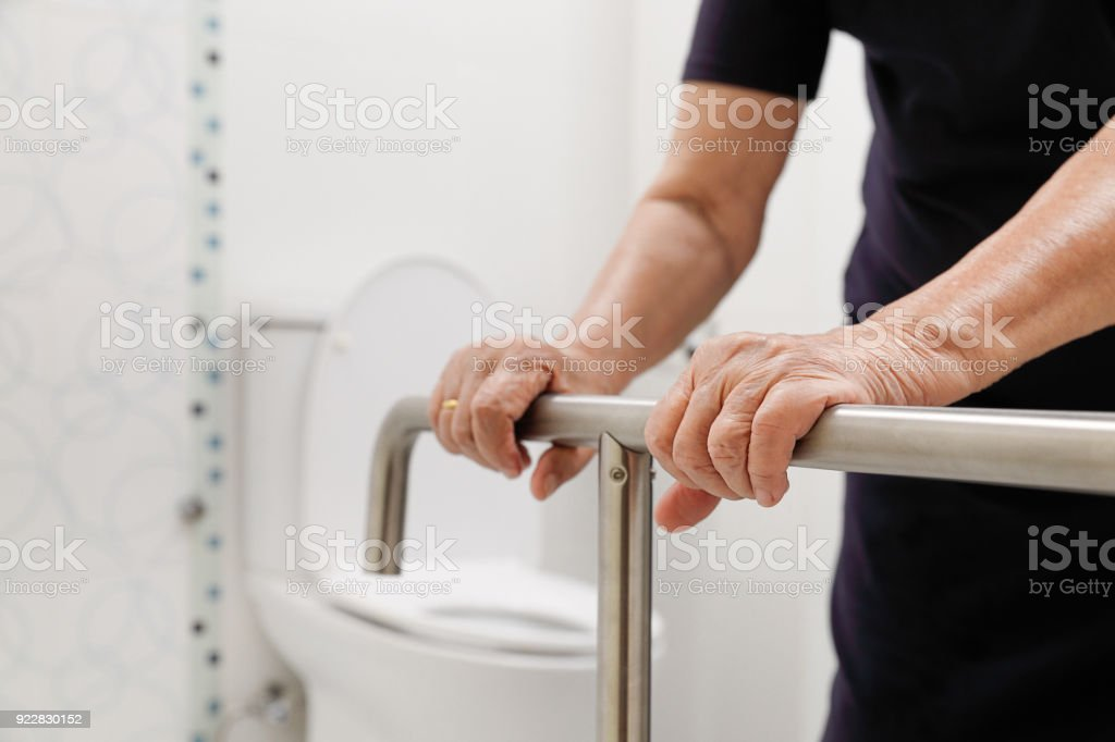 Elderly Woman Holding On Handrail In Bathroom Stock Photo & More ...