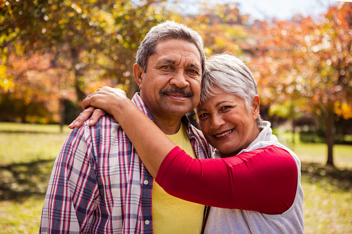 Elderly woman hugging his husband