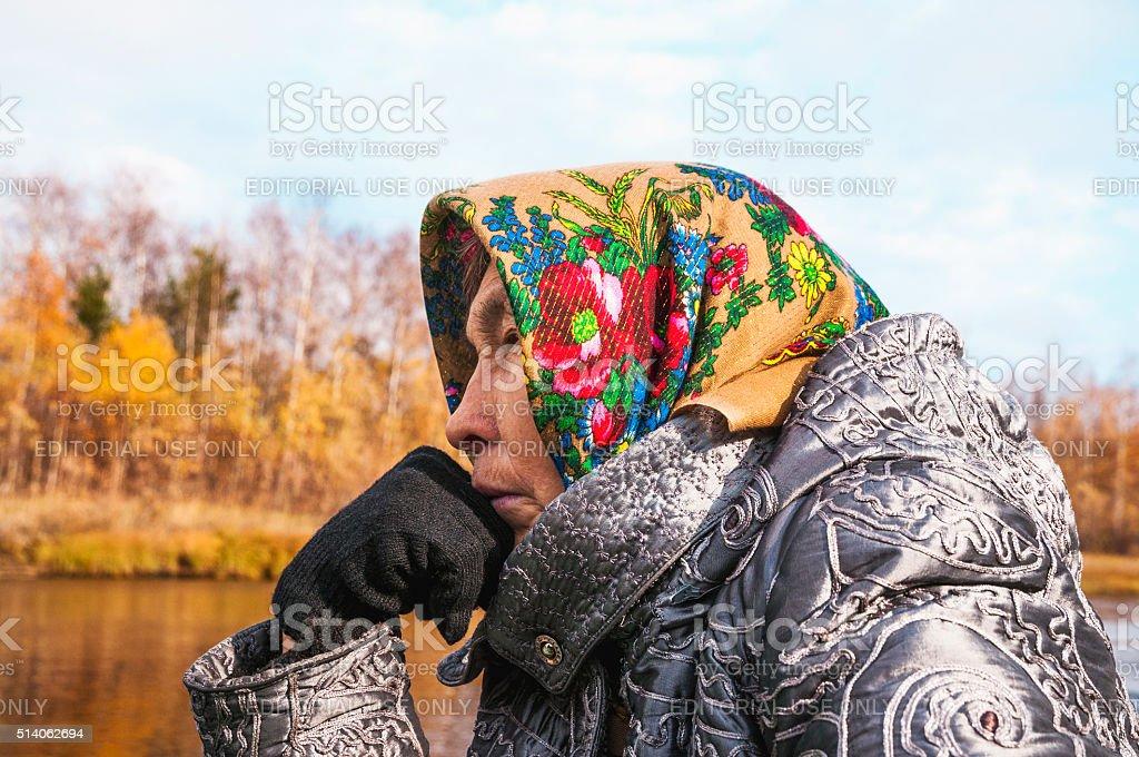Elderly woman in a boat on  river in Western Siberia. stock photo