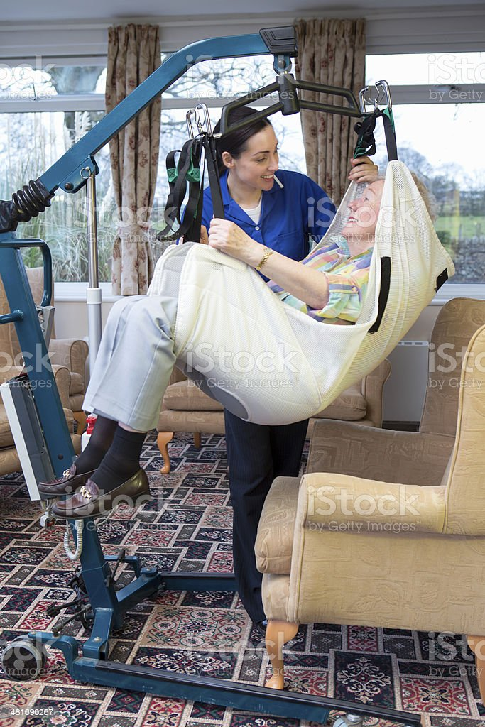 Elderly Woman in a Hoist stock photo