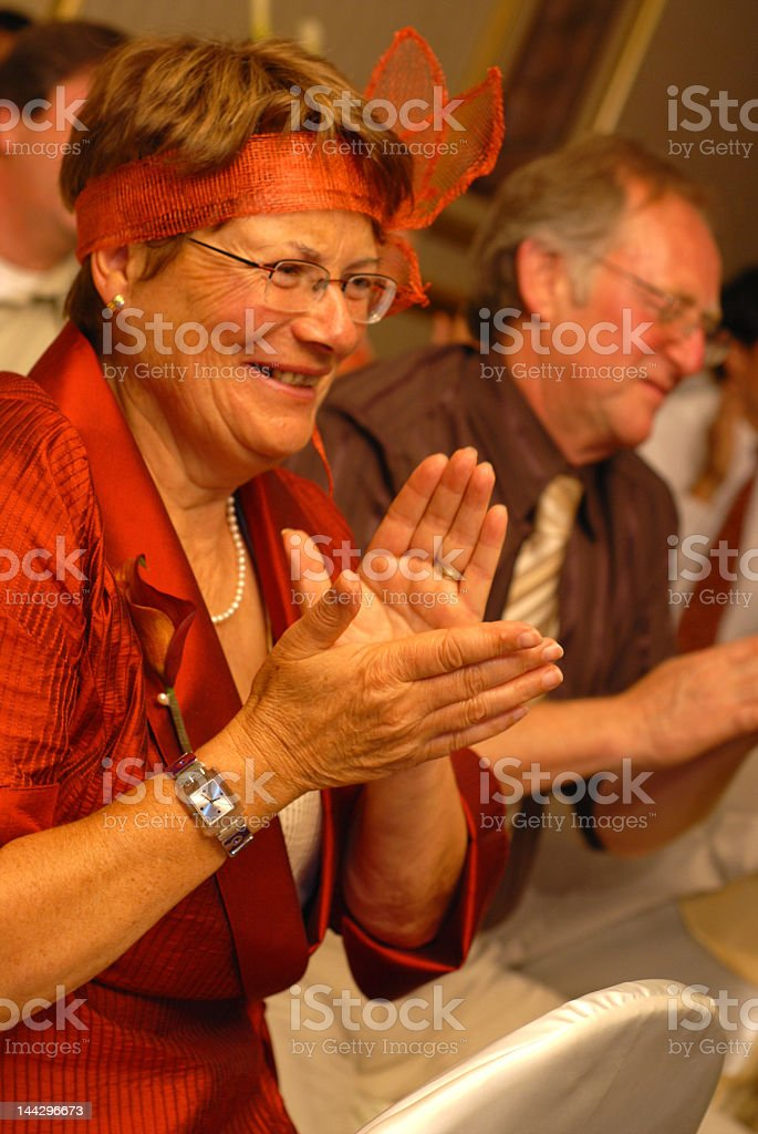 Elderly woman in audience clapping royalty-free stock photo