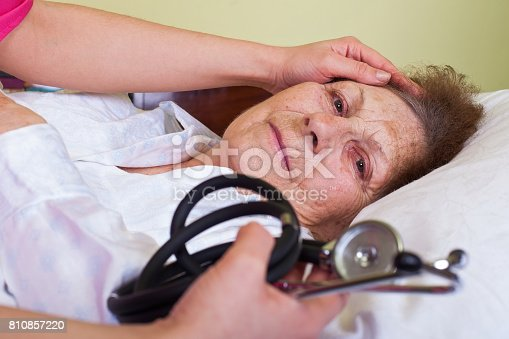 istock Elderly woman in bed 810857220