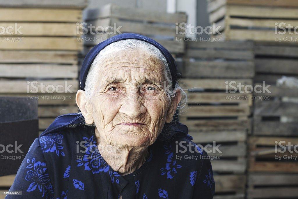 Elderly woman in dress royalty-free stock photo