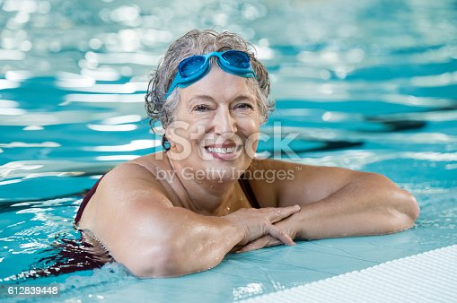 istock Elderly woman in pool 612839448