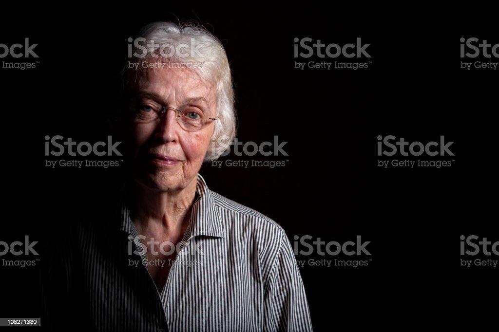 Elderly Woman in the Dark royalty-free stock photo