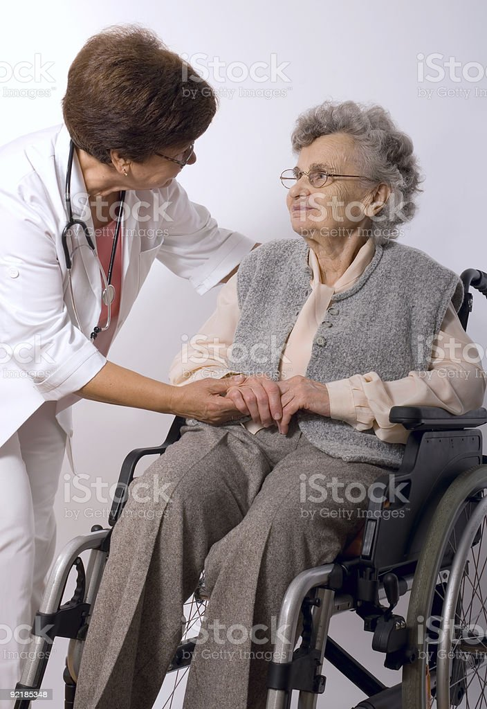 elderly woman in wheelchair royalty-free stock photo