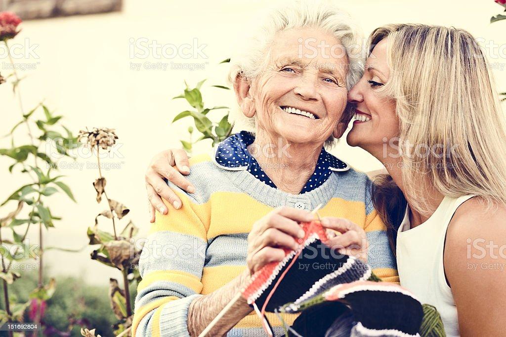 Elderly woman knitting stock photo