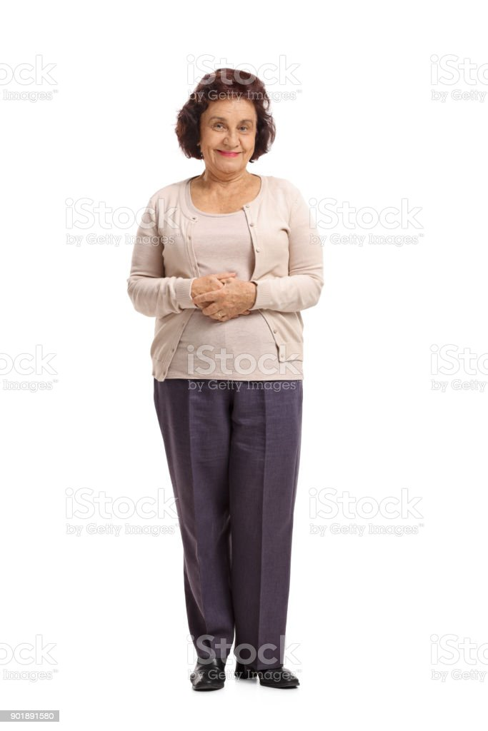 Elderly woman looking at the camera and smiling stock photo