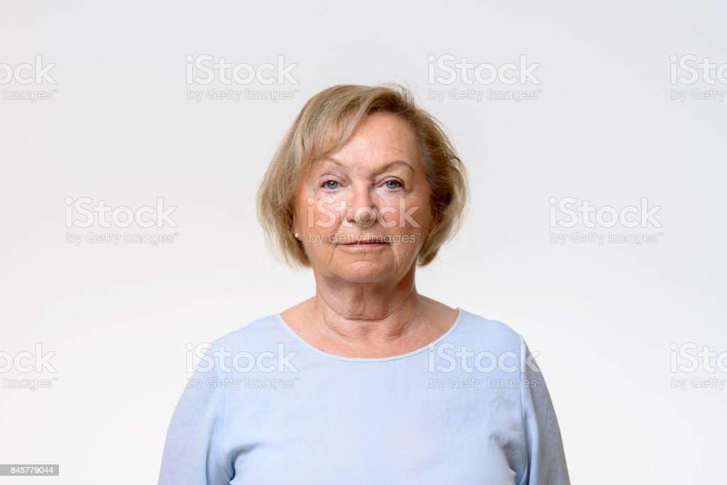 Elderly woman looking directly at the camera stock photo