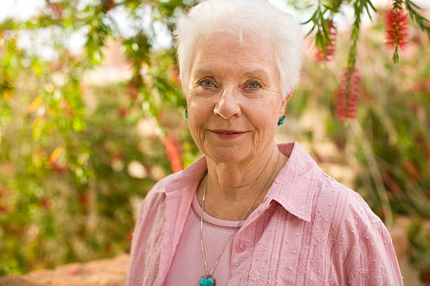 elderly woman portrait outside stock photo