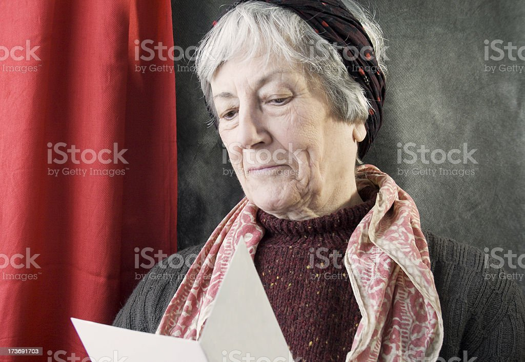 Elderly Woman Receives a Card. royalty-free stock photo
