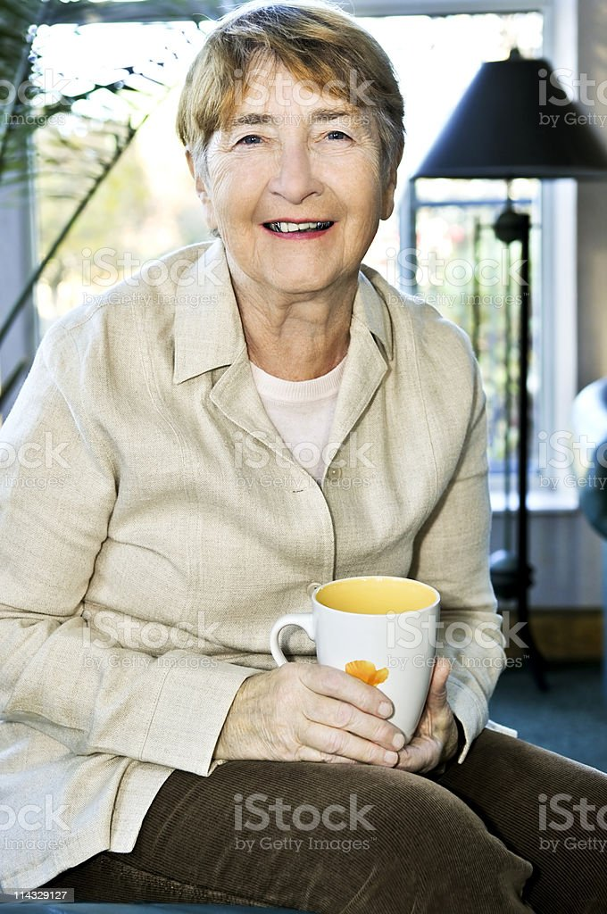 Elderly woman relaxing royalty-free stock photo