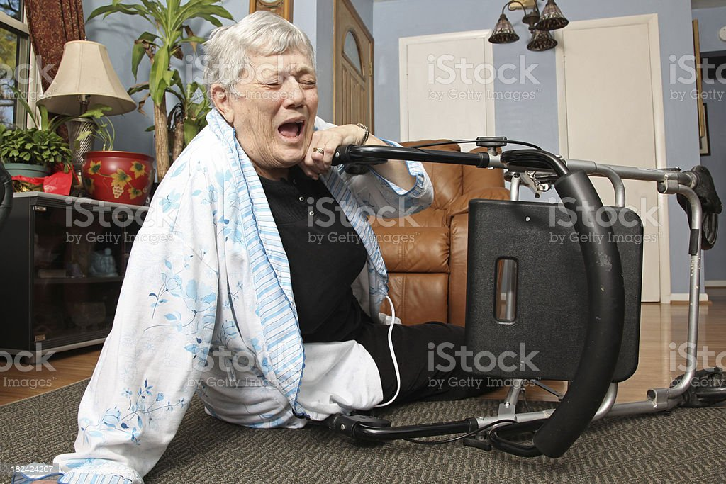 Elderly woman screams out in pain. royalty-free stock photo