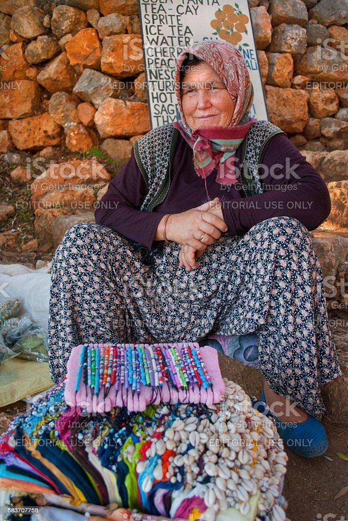Elderly woman selling souvenirs, Bird Island, Kusadasi, Turkey stock photo