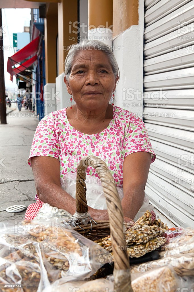 Elderly woman selling traditional mexican sweets in Oaxaca stock photo