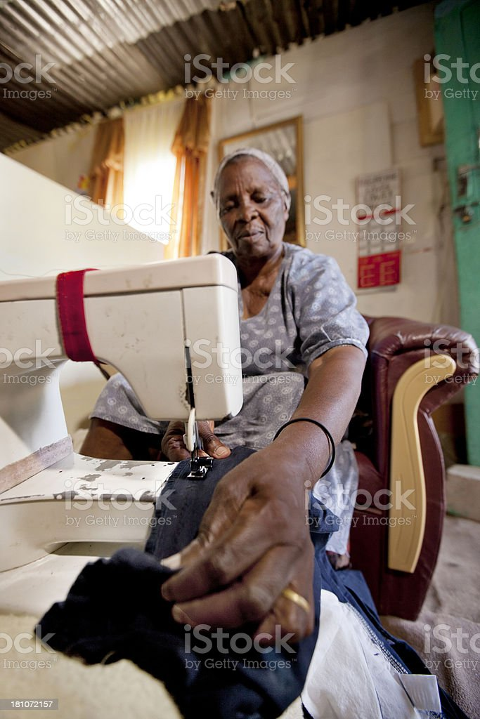 Elderly Woman Sewing, Gugulethu, Cape Town, South Africa. royalty-free stock photo