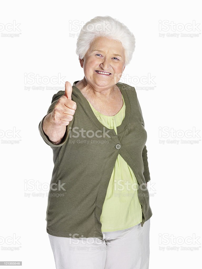 Elderly woman showing thumbs up sign royalty-free stock photo