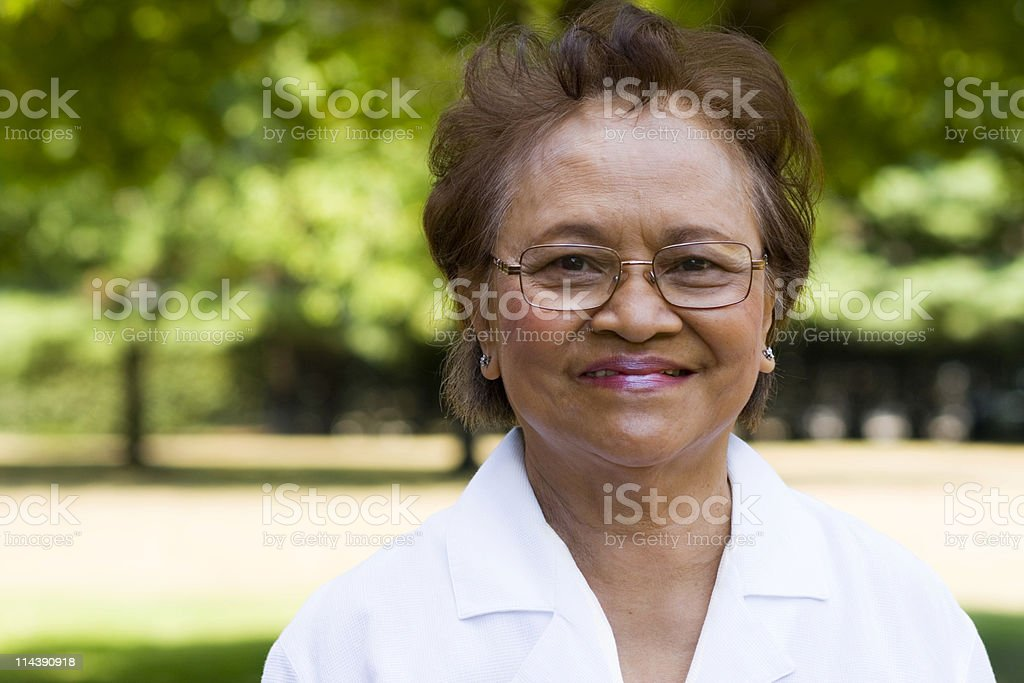 Elderly woman smiling at camera stock photo