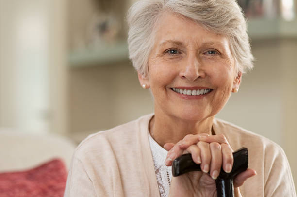 elderly woman smiling at home - geriatrics stock pictures, royalty-free photos & images