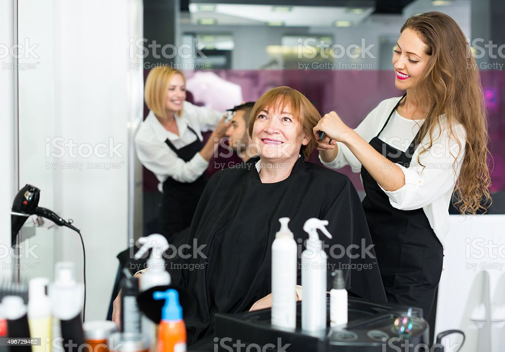 Elderly woman smiling at the hair salon stock photo