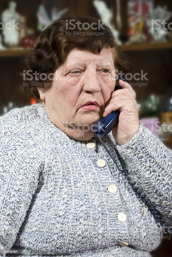 Elderly woman speaking at phone royalty-free stock photo