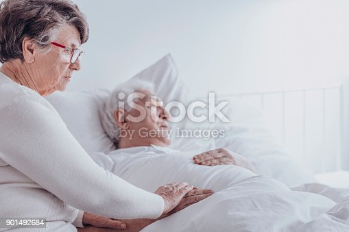 886711404 istock photo Elderly woman supporting sick husband 901492684