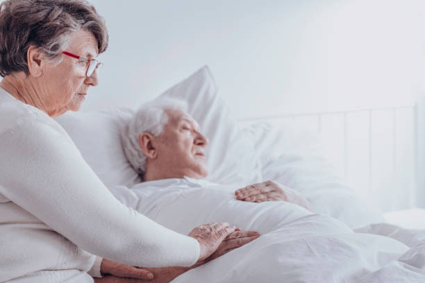 elderly woman supporting sick husband - cancer illness stock photos and pictures