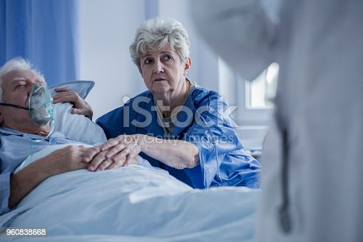 886711404istockphoto Elderly woman supporting sick man 960838668