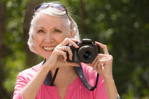 Elderly woman taking  picture