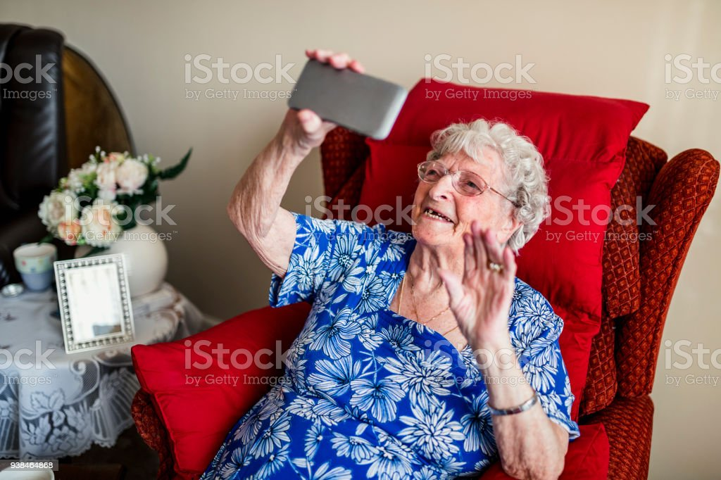 Elderly Woman Using A Mobile Telephone stock photo