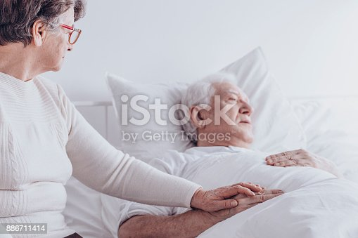 1049772134istockphoto Elderly woman visiting sick husband 886711414